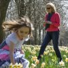 Family playing amongst daffodils